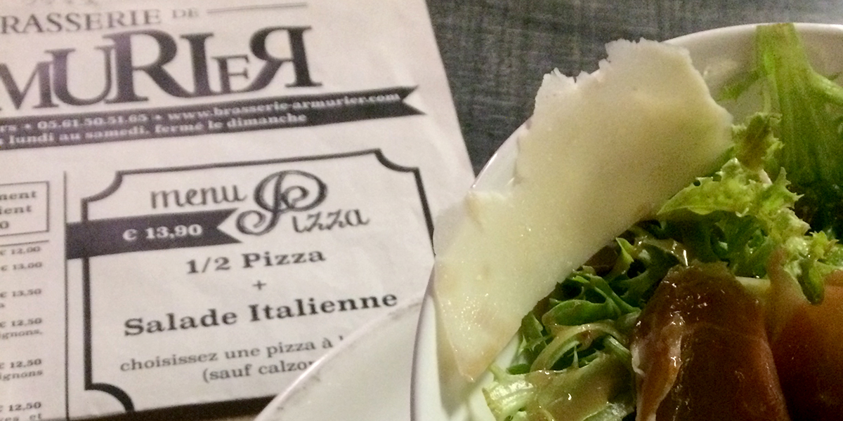 Newspaper style menu in French with a salad